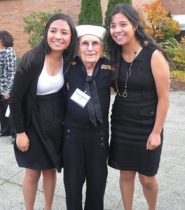 by: MaryLou Raney Marion Ellsworth, a World War II Navy veteran, poses with sisters Mackenzie, left, and Karen Martinez-Navarro at Living History Day on Nov. 9 at Reynolds High School. Both girls are seniors at the school.