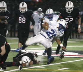 by: Jim Clark Gresham running back Devauntae Hoffman hurdles a tackler in the middle of the field during Friday's playoff loss at Lincoln.