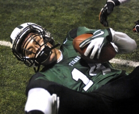 by: DAN BROOD IN FOR SIX — Tigard senior Brandon Wick grips the footall in the end zone on the first of his two TD catches in the Tigers' 56-21 win over Sprague.