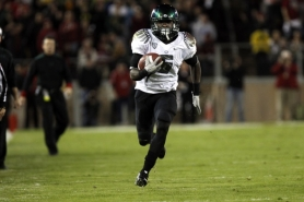 by: JAIME VALDEZ De'Anthony Thomas runs for an Oregon Ducks touchdown after catching a fourth-down pass from Darron Thomas during Saturday's game at Stanford.