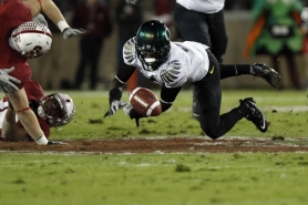 by: JAIME VALDEZ Oregon's De'Anthony Thomas loses the ball at the end of a nice run at Stanford.