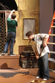 by: John Schrag Forest Grove High School senior Ian Lindsay, stage manager of the drama club's presentation of 'Arsenic & Old Lace,' put finishing touches on the set last week. The 1940s classic plays Friday and Saturday at 7:30 p.m. each night.