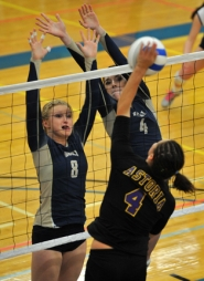 by: Zack Palmer Banks' Kaylin Vandomelen (8) and Abby Hardie (4) team up to block a shot by Astoria's Danielle Moyer during the quarterfinals of the Class 4A state volleyball tournament at Lane Community College on Friday.