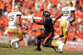 by: CHRISTOPHER ONSTOTT Oregon State receiver James Rodgers works against a double-team by UCLA. The senior from Texas figures to break Mike Hass' school record for pass catches, as he continues his return to prominence after knee surgery.