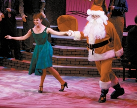 "by: Craig Mitchelldyer Amy Beth Frankel and Santa have a dance in the Broadway Rose Theatre Company's ""A Very Merry PDX-MAS."""