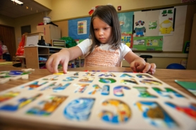 by: CHRISTOPHER ONSTOTT Four-year-old Sarah Suprun plays with an alphabet puzzle at preschool. Just 11 of the 60 kindergartners at Earl Boyles this year came in with any preschool experience.The high-poverty neighborhood is underserved by Head Start, Early Head Start and other programs.