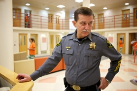 by: Jaime Valdez Sheriff Rob Gordon checks in with staff in an inmate pod within the Washington County Jail on Monday.