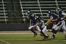 by: VERN UYETAKE  Jasper Yidrim sprints downfield after recording an interception in Lake Oswego's blowout opening-round victory on Friday.