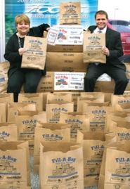 by: jim Clark Bess Wills, left, Gresham Ford general manager, and Casey Ryan, Riverview Community Bank vice president and branch manager in East County, hold bags that will be used to collect food for SnowCap. The bags were inserted in the Wednesday, Nov. 16, edition of The Gresham Outlook. Donors can also help by donating money, using the envelope attached to the bags.