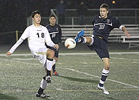 by: Miles Vance JOUSTING — Southridge's Thomas Peterson (left) and Westview's Hunter Pinson battle for control of the ball during the Wildcats' 1-0 win on Saturday at Southridge High School.