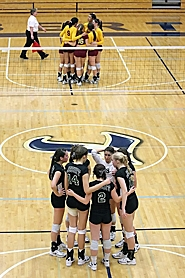 by: Miles Vance POISED AND READY — The Jesuit volleyball team gathers together prior to the beginning of its state championship match against Central Catholic at Liberty High School on Saturday.