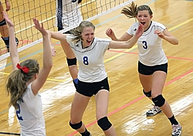 by: Miles Vance OH YEAH — Valley Catholic's Rebecca Baglai (center) and Maddie Bernard celebrate a point during their team's loss to Blanchet at the Class 3A state volleyball tournament