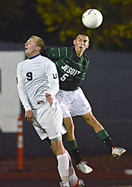 by: Vern Uyetake HIGH FLYERS — Jesuit's Brian DeGrandmont and LO's Ryan Favero go after a header on Saturday.