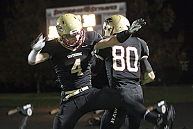 by: Miles Vance TD TIME — Southridge's Justin Calo (left) and Jordan Morgan celebrate one of Morgan's two touchdowns against Century on Friday night.