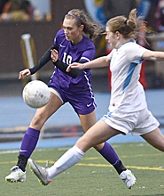 by: Vern Uyetake TOUGH 'D' — Sunset's Ashley Rogers knocks the ball away from a Lakeridge player during her team's 4-2 win on Saturday at Lakeridge High School.