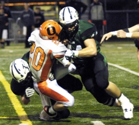 by: DAN BROOD TIGER TACKLE — Tigard High School senior Jesse Wantland (right) and junior Matt Franz bring down Sprague's Taylor Page in Friday's state playoff game.