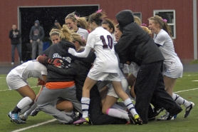 by: DAN BROOD WHAT A WIN — Players on the Sherwood High Schoo girls soccer team mob Lady Bowmen junior goalie Mikaela Doherty after she made the victory-clinching save during the penalty-kick shootout on Saturday.