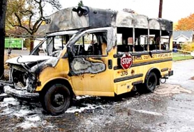 by: Courtesy of PFR A school bus driver got all six students off this vehicle safely before it burst into flames early Friday morning. Investigators are still trying to figure out what started the fire.