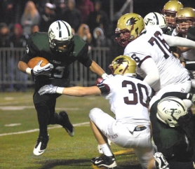 by: DAN BROOD ZACH ATTACK — Tigard junior running back Zach Floyd (left) looks to get past Southridge's Eric Scruggs (30) and Nico Klotzbach in Friday's state playoff game. Floyd had three TDs for the Tigers in their 48-17 win.