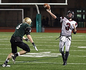by: Miles Vance WING IT – Tualatin senior quarterback Travis Johnson releases a pass in his team's 22-14 loss to Jesuit in the second round of the Class 6A state playoffs on Friday at Jesuit High School.