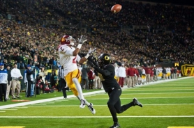 by: MICHAEL WORKMAN USC's Robert Woods hauls in a touchdown pass behind Oregon cornerback Avery Patterson.