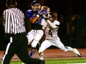 by: JAIME VALDEZ Grant High's Cordell Harris makes a 64-yard touchdown grab against Canby defender Andrew Welch.