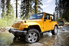 by: CHRYSLER MOTORS The Pentaster V6 engine and interior may be new, but the 2012 Wrangler still looks and drives like a Jeep.