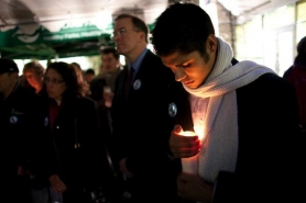 by: Christopher Onstott James Marquez (right) honors the life of his brother Julio Cesar Marquez, whose body was found by two boys on their way to school Nov. 6, during a candlelight vigil Monday at the East Portland Community Center.