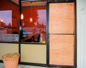 by: Elizabeth Ussher Groff In the early morning hours of October 25th, after a break-in at Woodstock Eye Styles, East Precinct officers arranged for the door to be boarded up, before they left the scene after their investigation. A computer stolen in the crime was later recovered.