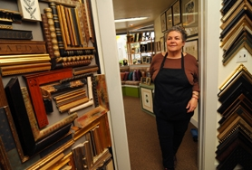 by: VERN UYETAKE Cris Pera has owned and operated The Artisan frame shop in downtown Lake Oswego for 24 years. The shop will close its doors for good Dec. 23.