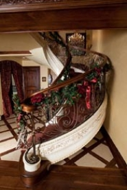 by: submitted photos The French Provencal-inspired Wilson home features a hand-pressed, grand staircase with iron railings. The home also boasts many hand-painted murals.