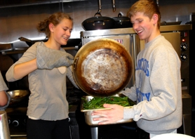 by: barb randall Jennie Hubbard and Nathan Gruenberg work together to get sauteed green beans ready to transport.