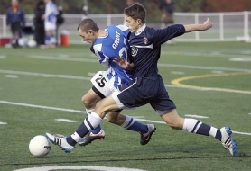 by: MILES VANCE In the state championship soccer game, Grant's Hayden Swanson (left) races Westview's Hunter Pinson for the ball.