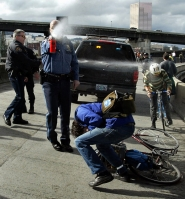 by: L.E. BASKOW Protesters, police and pepper spray are not a new combination in Portland. Eight years ago, police pepper-sprayed demonstrators who took control of the Morrison Bridge and blocked traffic for about an hour to protest the start of the Iraq War.