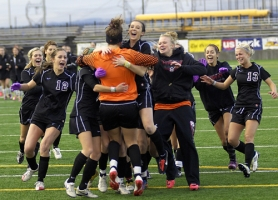 by: DAN BROOD WE DID IT — The Lady Bowmen rush goalie Mikaela Doherty following the penalty-kick shootout on Saturday.