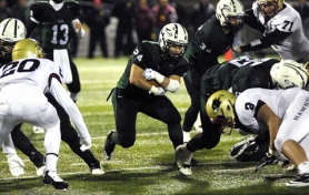 by: DAN BROOD ROOM TO RUN — Tigard junior running back Benny Wick sprints through a hole opened up by linemen Jeremy Moore and Jarrad Schulte during the Tigers' 48-17 state playoff victory over Southridge on Friday.
