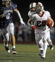 by: JAIME VALDEZ ONE OF MANY — Sherwood senior halfback Paul Dodson (right) is one of a number of weapons for the Bowmen offense.