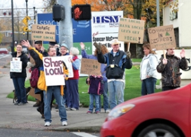 by: Jim Clark A dozen Occupy protesters march  in Gresham on Friday, lending support for local business and banks, rather than large corporations.