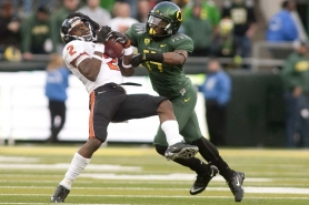 by: CHRISTOPHER ONSTOTT The Oregon defense, including cornerback Ifo Ekpre-Olomu, kept clamps on Oregon State receiver Markus Wheaton (left) and the Beavers' offense.