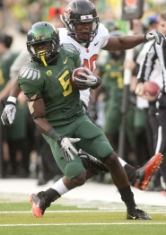 by: CHRISTOPHER ONSTOTT De'Anthony Thomas takes off against Oregon State, helping Oregon win in a rout 49-21 at Autzen Stadium.