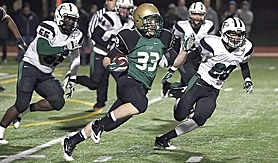 by: Miles Vance MORGAN'S RUN — Jesuit senior tailback Morgan Sellers runs past (from left) Tigard's Jeremy Moore, Jarrad Schulte, Benny Wick and Manu Rasmussen during his team's 35-7 home win over the Tigers on Friday in the Class 6A state quarterfinals.