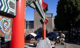 by: CHRISTOPHER ONSTOTT Portland's Chinatown Gate frames the Right 2 Dream Too campground, which may soon become a permanent outdoor facility for the homeless thanks to a new bureau of development services ruling.