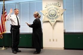 by: Jaime Valdez The Honorable Kirsten Thompson swears in Washington County Sheriff Pat Garrett during a ceremony Wednesday afternoon in Hillsboro.