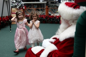 by: Jaime Valdez Cousins Ellie Stanton (left) and Paula Johnson, both 3, approach Santa Claus this week at Washington Square. The girls were brought to the mall Monday by their grandparents, Janine and Skip Stanton of Metzger.