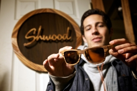 by: Jaime Valdez Eric Singer shows off a pair of wooden shades his company creates in Shwood's Beaverton workshop off of Southwest Allen Boulevard.