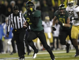 by: JAIME VALDEZ Oregon's LaMichael James runs for his first touchdown in the Pac-12 title game versus UCLA Friday night at Autzen Stadium.