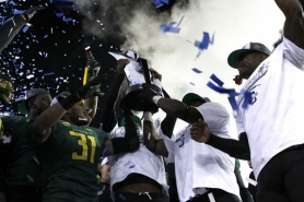 by: JAIME VALDEZ The Oregon Ducks got to celebrate on their home field Friday night after beating UCLA for the Pac-12 championship in the final game as Bruins coach for Rick Neuheisel, who was fired on Monday.