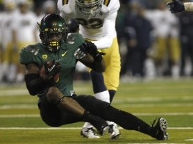 by: JAIME VALDEZ Josh Huff hauls in a catch for the Oregon Ducks in Friday night's Pac-12 championship victory over UCLA, 49-31, at Autzen Stadium.