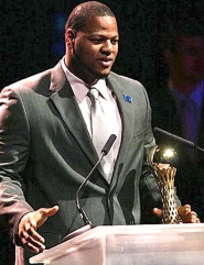 by: Tribune File Photo Ndamukong Suh accepted the Bill Hayward Award during the 2009 Oregon Sports Awards. He and two passengers were not hurt in an early Saturday morning car crash in downtown Portland.