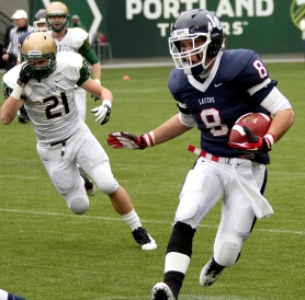by: Miles Vance Lake Oswego receiver Jack Anderson is chased by Jesuit's Trent Werner after making a catch in his team's 21-13 victory in the Class 6A state semifinals at Jeld-Wen Field on Saturday.